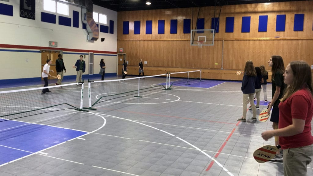 Student Playing badminton